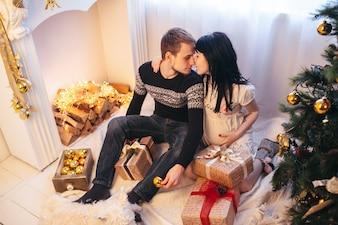 Beautiful couple in expectancy celebrating Christmas