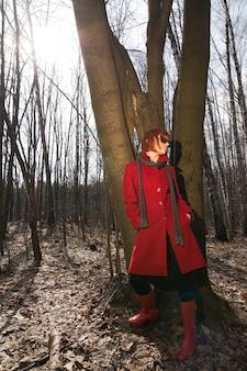 Beautiful girl wearing red coat and sunglasses