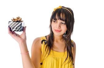 Beautiful girl with gift box