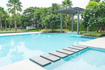 Beautiful luxury swimming pool with palm tree