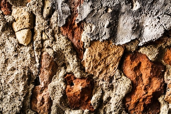 Beautiful Old Grunge Uneven Brick Texture of Concrete Rough Wall. Gray Color. Background Backdrop. Horizontal.