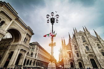 Beautiful Panoramic view of Duomo square in Milan with big stree