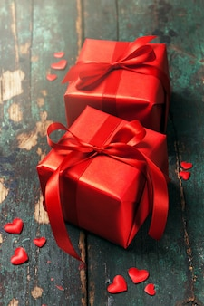 Beautiful red Gifts on a Wooden Background. Christmas, Xmas, Val