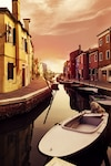 Beautiful Sunset with Boats, Buildings and Water Sun Light Toning Burano, Italy