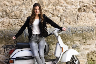 Beautiful teenager with a white scooter
