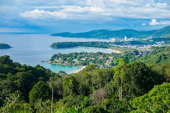 Beautiful turquoise ocean waives with boats and sandy coastline from high view point. Kata and Karon beaches, Phuket, Thailand