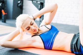 Beautiful woman doing abs exercises