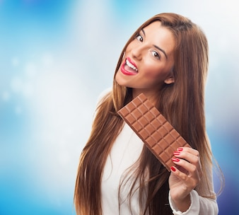 Beautiful woman with bar of chocolate