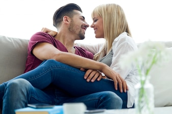 Beautiful young couple in love at home.