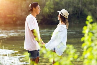 Beautiful young couple in love in the mountain.