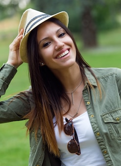 Beautiful young woman walking in the park.