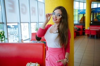 Beautiful young woman with white glasses smiling