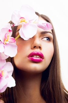 Beauty spring portrait of tender seductive lady with pink flowers, big lips and natural make up