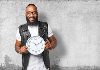Bespectacled man holding a clock