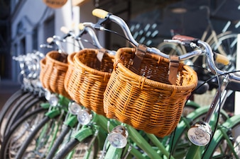 Bicycles placed in line with wicker basket