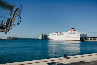 Big cruise ship docked at port.