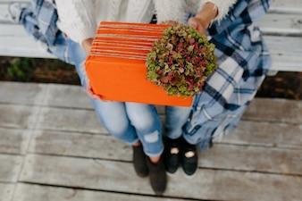 Big orange gift held by two girls