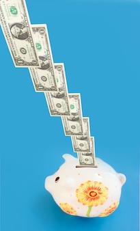Bills entering a piggy bank