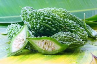 Bitter melon or Bitter gourd on banana leaves