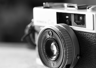 Black and white image of film cameras that had been popular in the past