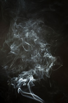 Black background with dynamic smoke silhouette