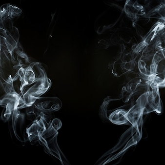Black background with two smoke silhouettes in motion
