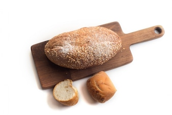 Black coffee and whole wheat bread for breakfast on white background