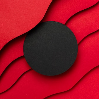 Black empty circle and wavy layers of red background