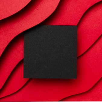 Black empty paper and wavy layers of red background