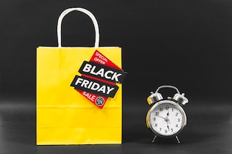 Black friday concept with alarm next to bag