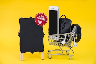 Black friday sales concept with cart and board