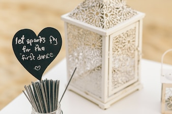 Black heart with lettering 'Let sparks fly for the first dance'