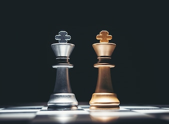 Black King and white on the board .The most powerful figures. Set of chess figures.