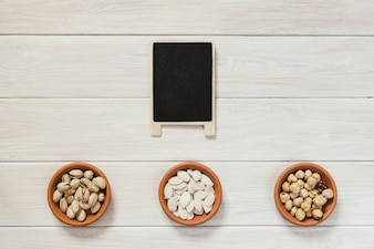 Blackboard and bowls with nuts and seeds