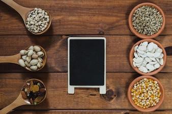 Blackboard near seeds and nuts
