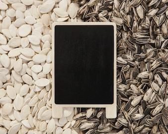 Blackboard on pumpkin and sunflower seeds