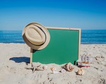 Blackboard on sandy beach
