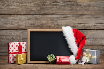 Blackboard with a hat santa claus