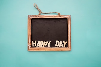 Blackboard with  happy day  lettering