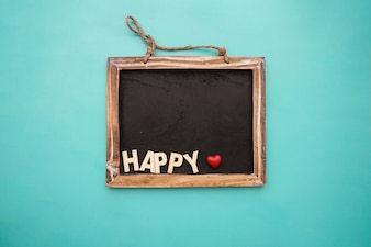 Blackboard with happy lettering and heart