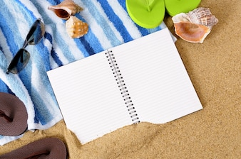 Blank notebook on the beach