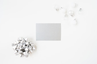 Blank paper with a silver tie