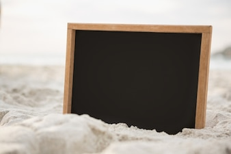 Blank slate in sand