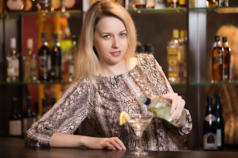 Blond girl bartender at work