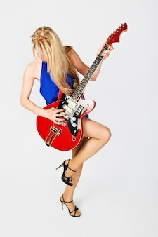 Blond girl with electric guitar