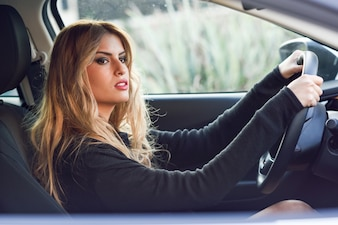 Blond woman driving a car