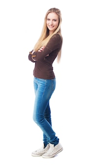Blond woman with jeans and crossed arms