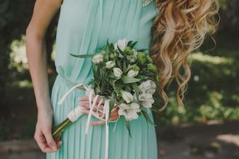 Blonde bridemaid with bouquet