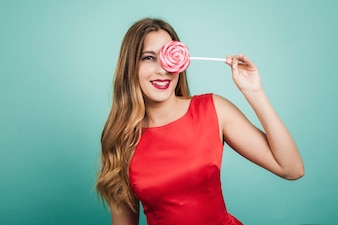 Blonde girl playing with a lollipop