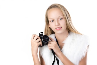Blonde girl posing with her camera